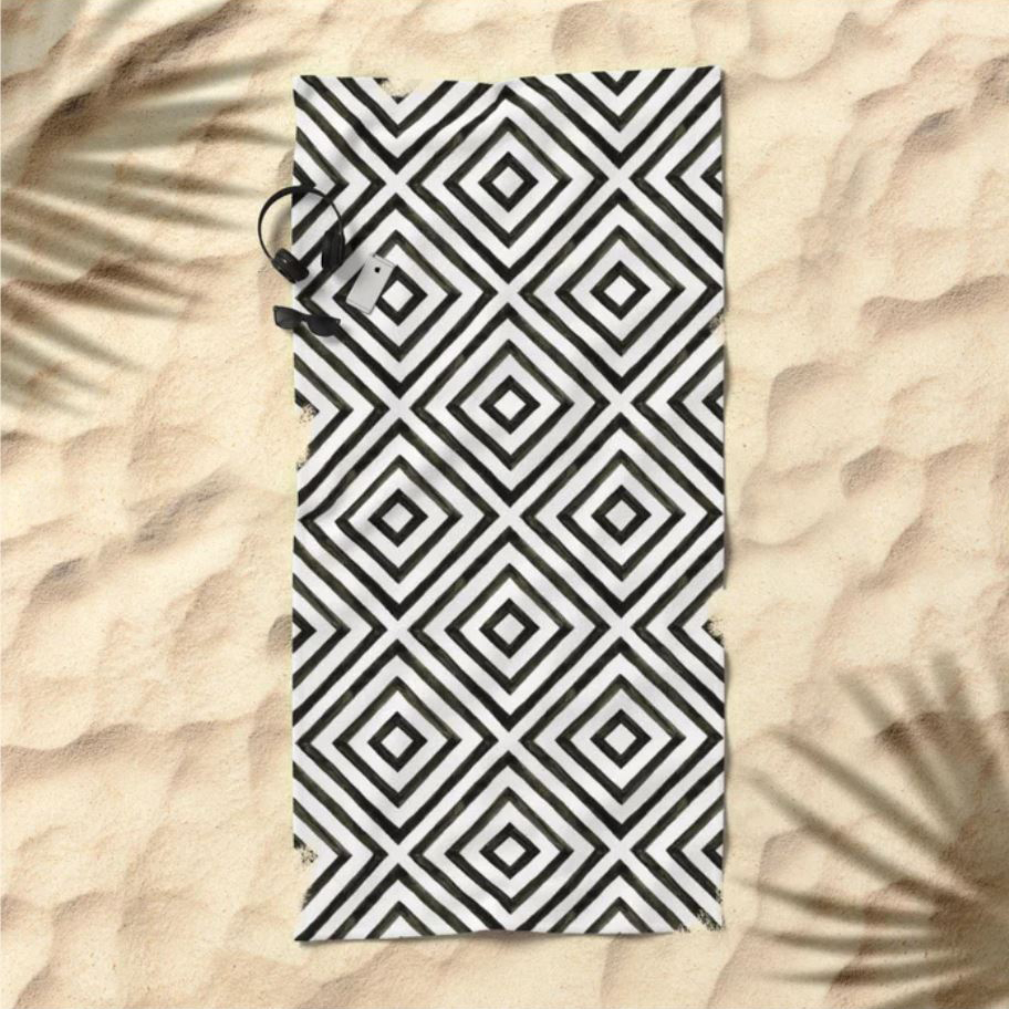 Work on your tan on this stylish and dynamic pattern of black squares on a geometric grid would look get on any beach.