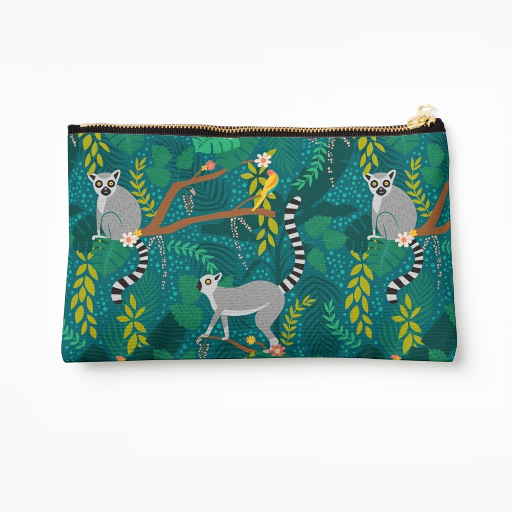 Teal jungle bag covered in lemurs and floral leaves celebrating this cute creatures