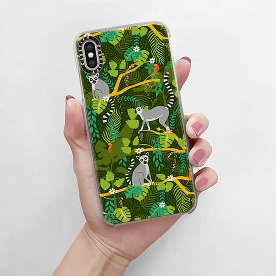 This phone case is adorable!!! love the lush green vegetation with the bright red parrots and lemurs on tree limbs