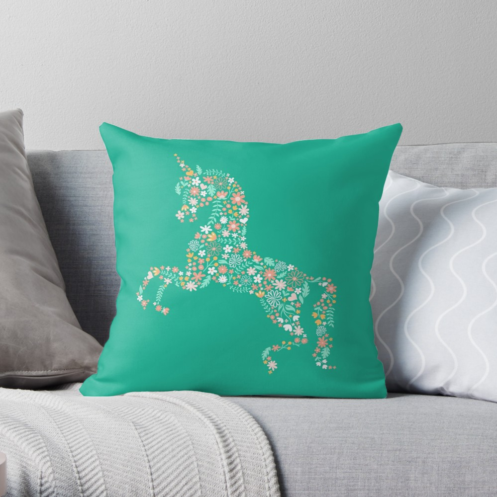 Cute teal throw pillow of unicorn on bright teal green with lots of flowers. Prefect to cuddle in a nursery, use as nursing support, or would look really cool in a tween's bedroom