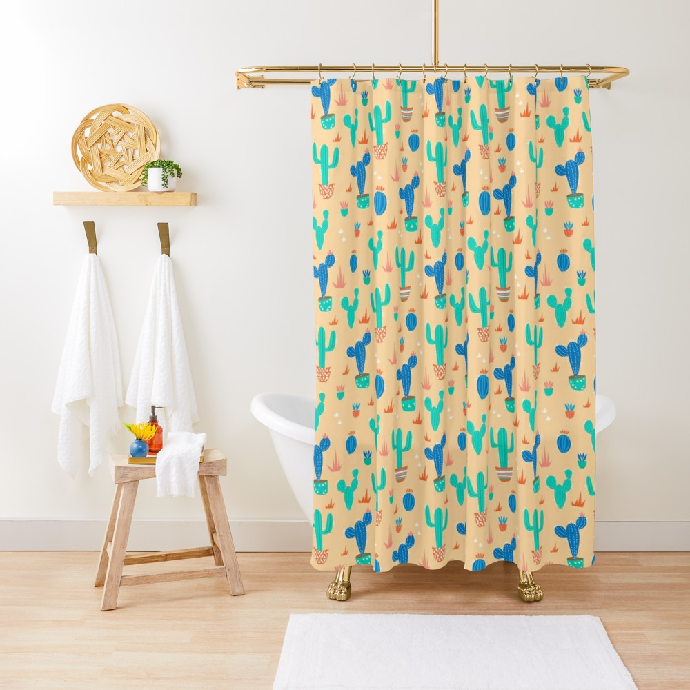 Dress up your new apartment or dorm room in style with this cactus patterned shower curtain in sandy yellow with bright blue cacti all over. Can be used in the bathroom shower or as a room divider.