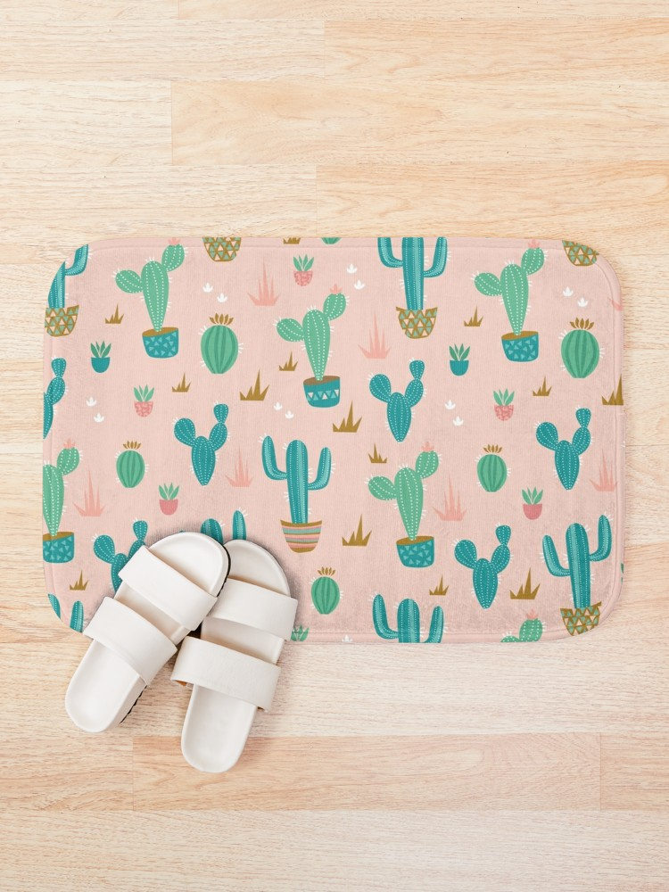 blush pink mat with teal cacti and gold accents make this modern desert vibe the best for your new space.