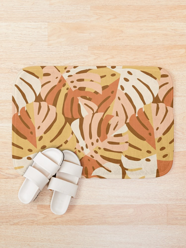 Warm earth tones make this the perfect chill bath mat for your bathroom and pull from the color scheme to design the rest of your bath makeover in blush pink, rust, and a creamy yellow gold