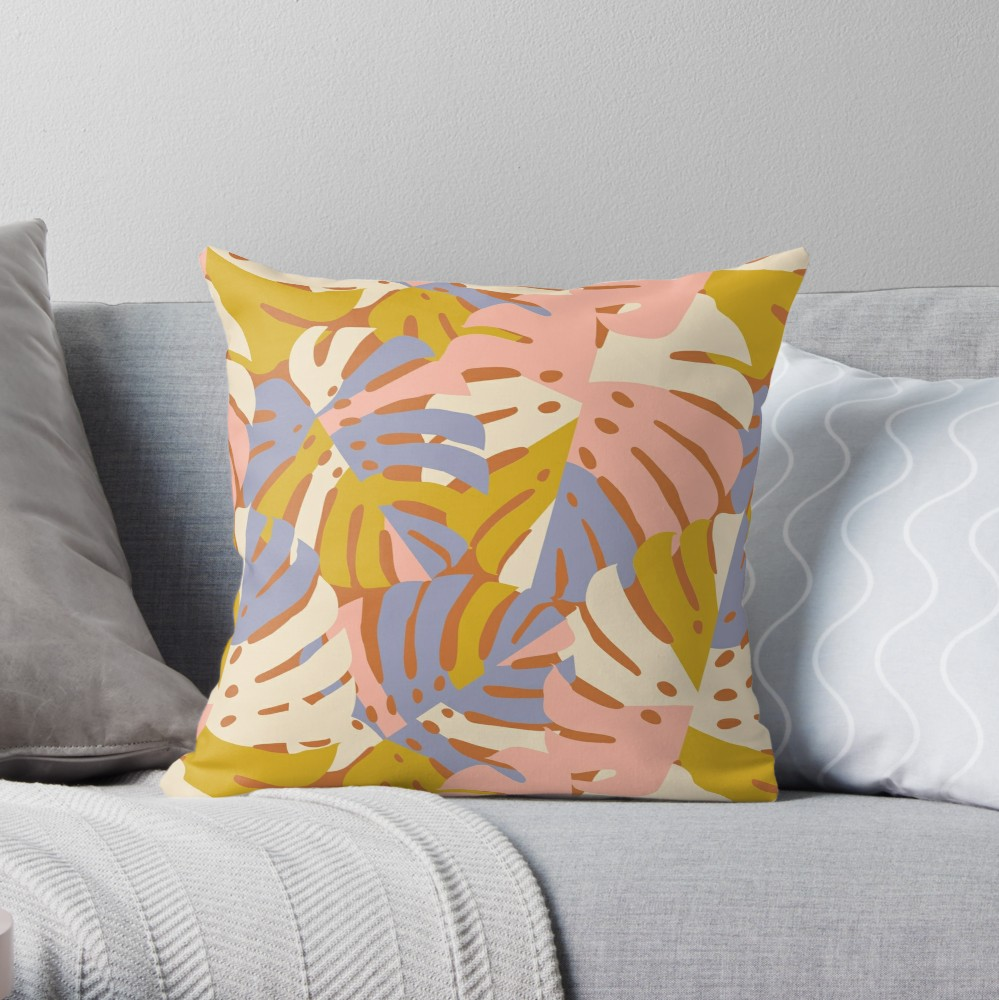Soft pastel hued tropical leaves pattern in pink lavender and a mustard yellow that adds some funky modern style to your living your or the pillow collection on your bed