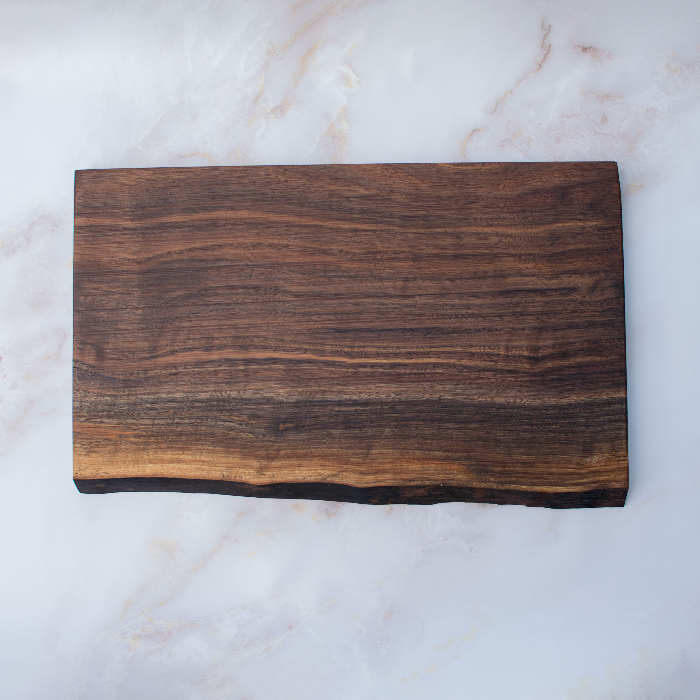 Cheese board on marble. dark natural wood