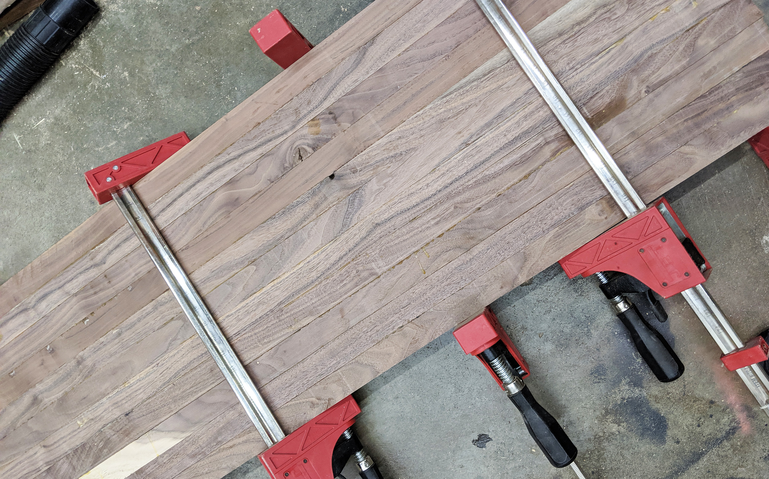 First Laminated of our walnut cutting boards. This process occurs twice with planing and sandy happening in between