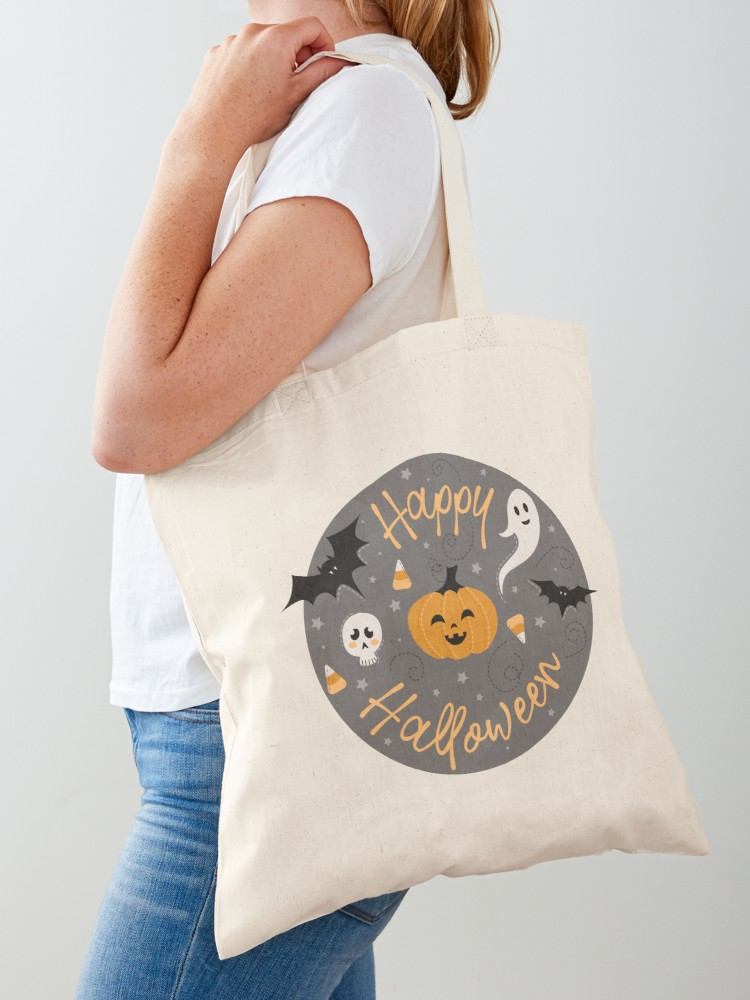 Happy Halloween Tote Bag with cute bats, skulls, candy corn, ghosts on a circle emblem