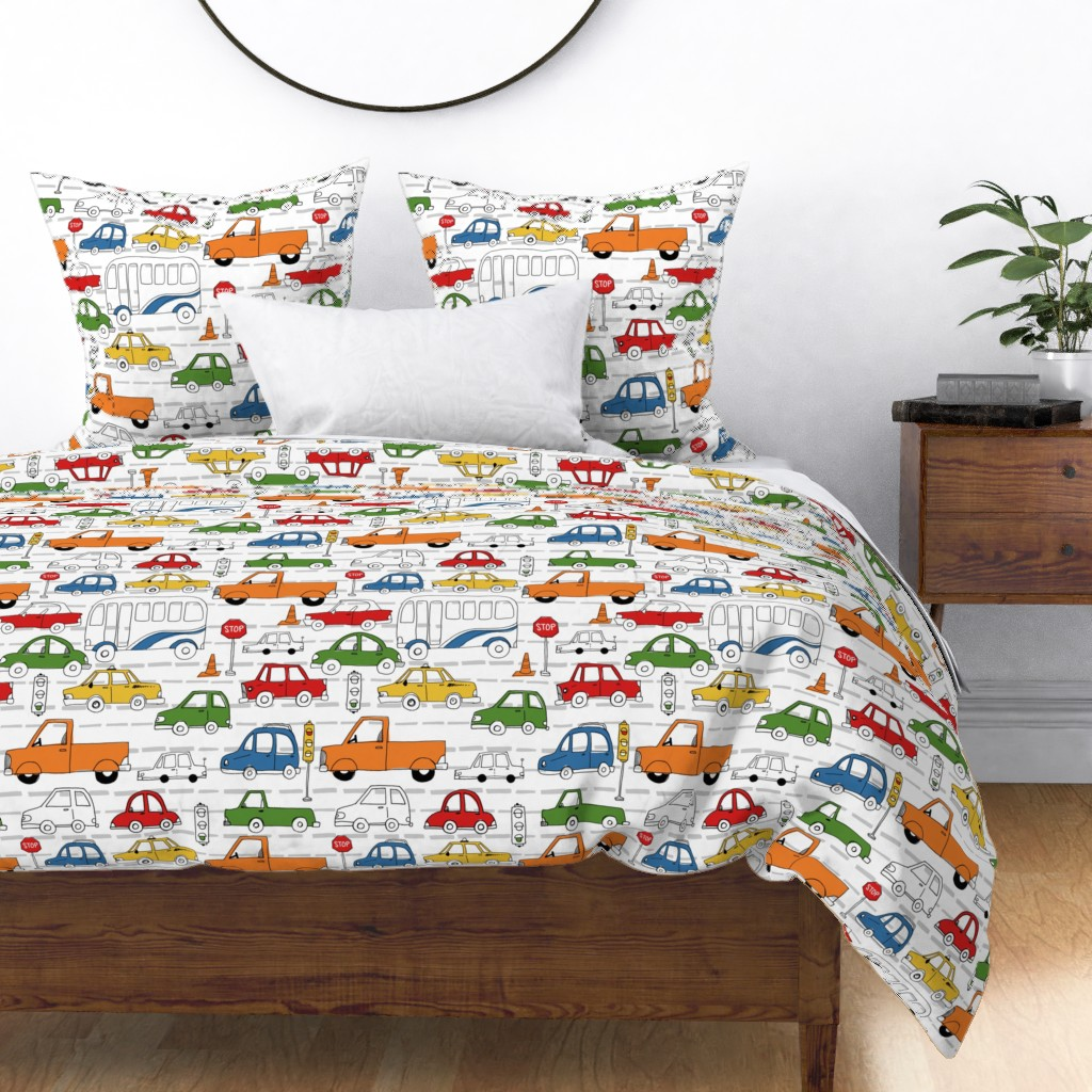 Lots of cars and trucks fill this duvet cover and matching pillow shams - great for a little boy's room who loves all things car