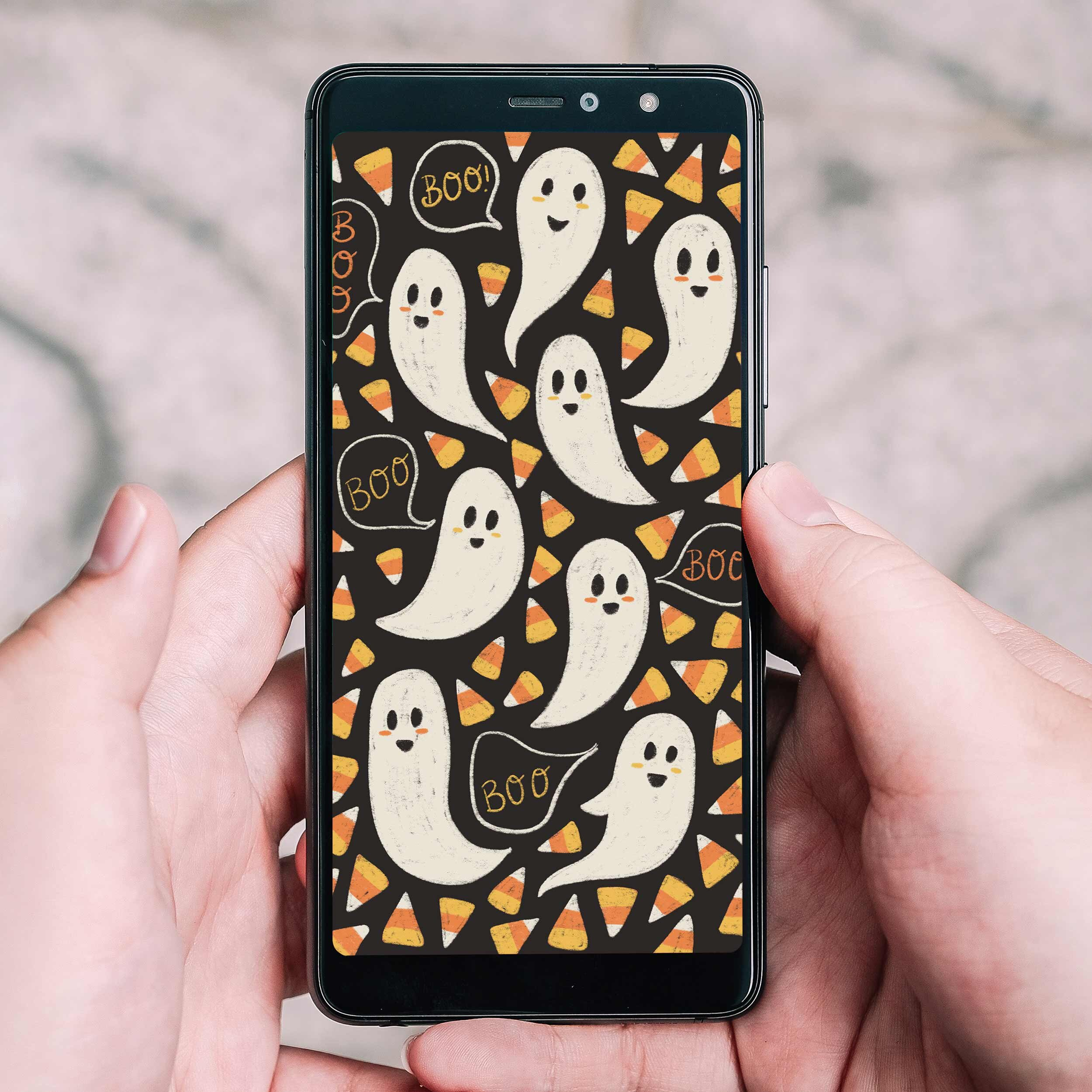 Friendly ghost hand drawn phone wallpaper with lots of candy corn to use as your phones backdrop this Halloween season.