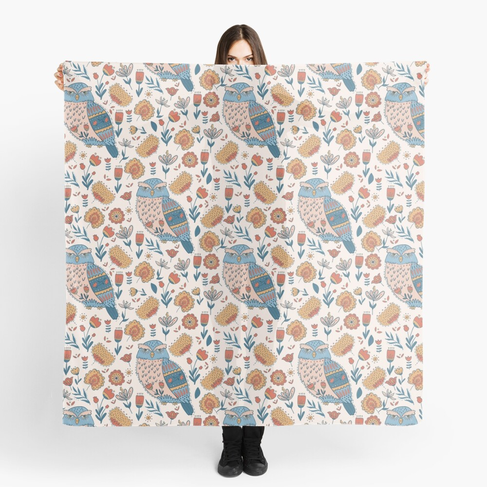 Pattern owl scarf in traditional scandinavian hues of blue, red, and yellow