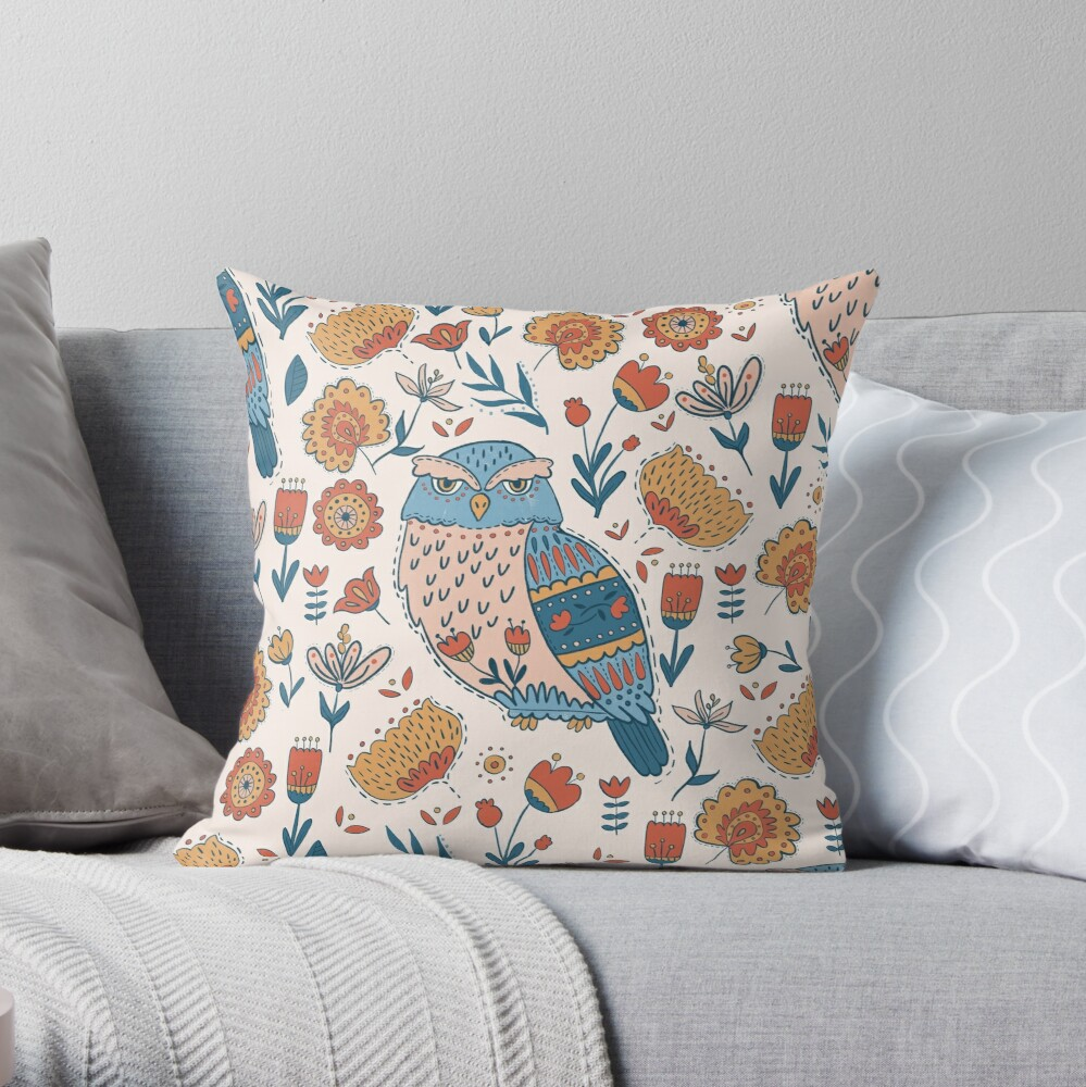 Folk style throw pillow with lots of flowers and pretty hand drawn detailed