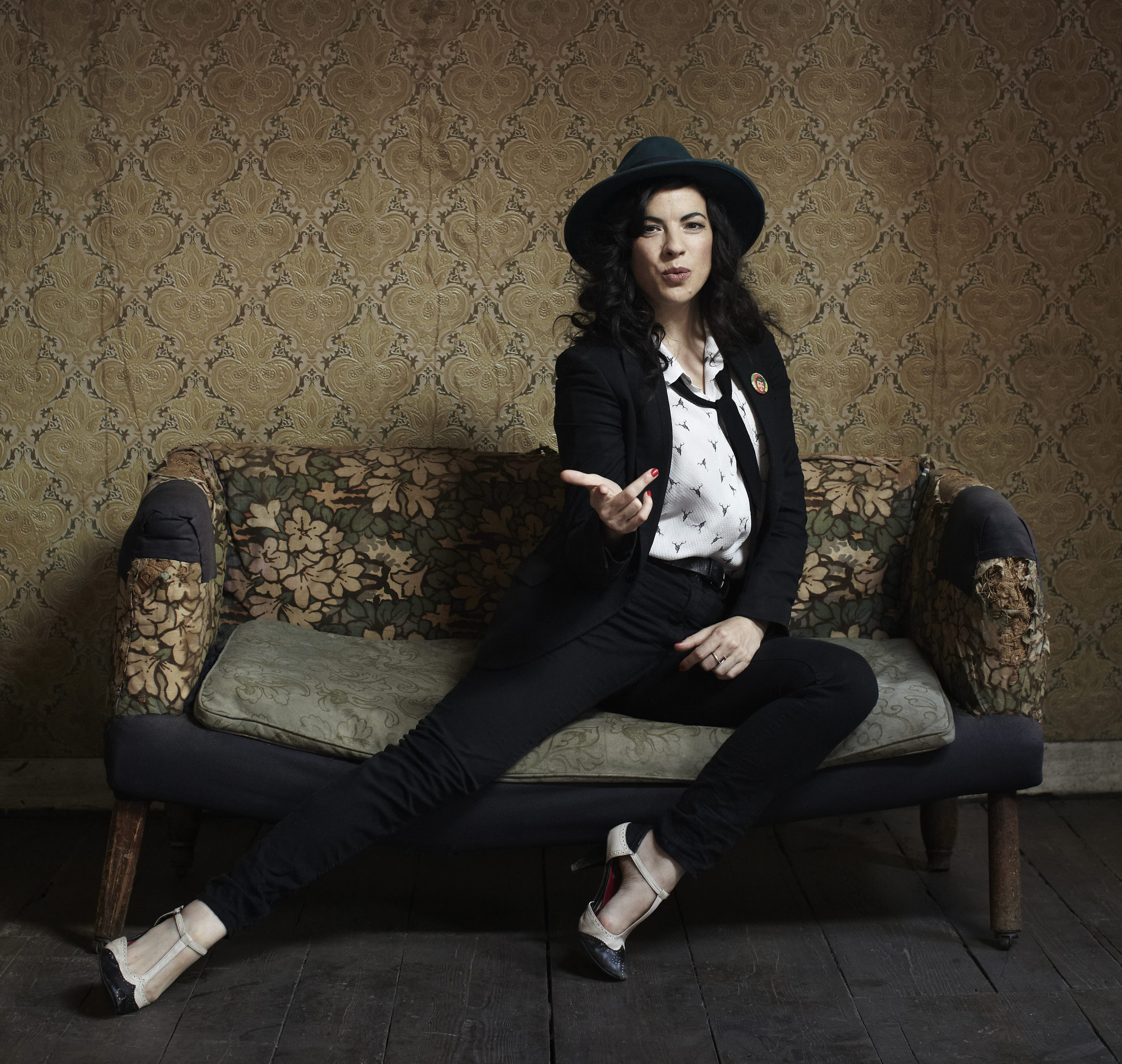 Camille OSullivan - with couch, green hat (c) Jamie Baker.jpg