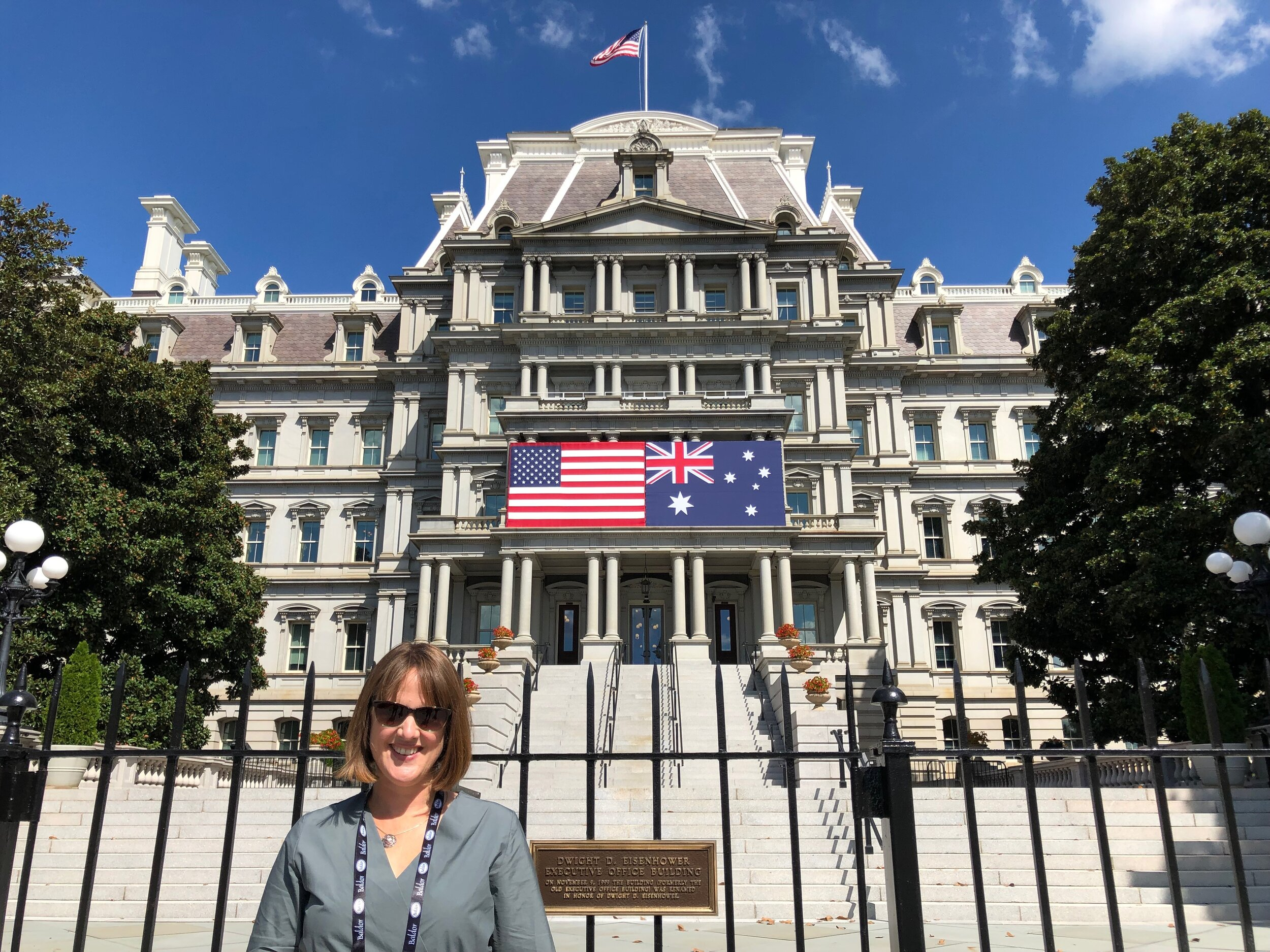 Claire pictured in front of the historic Eisenhower Executive Office Building