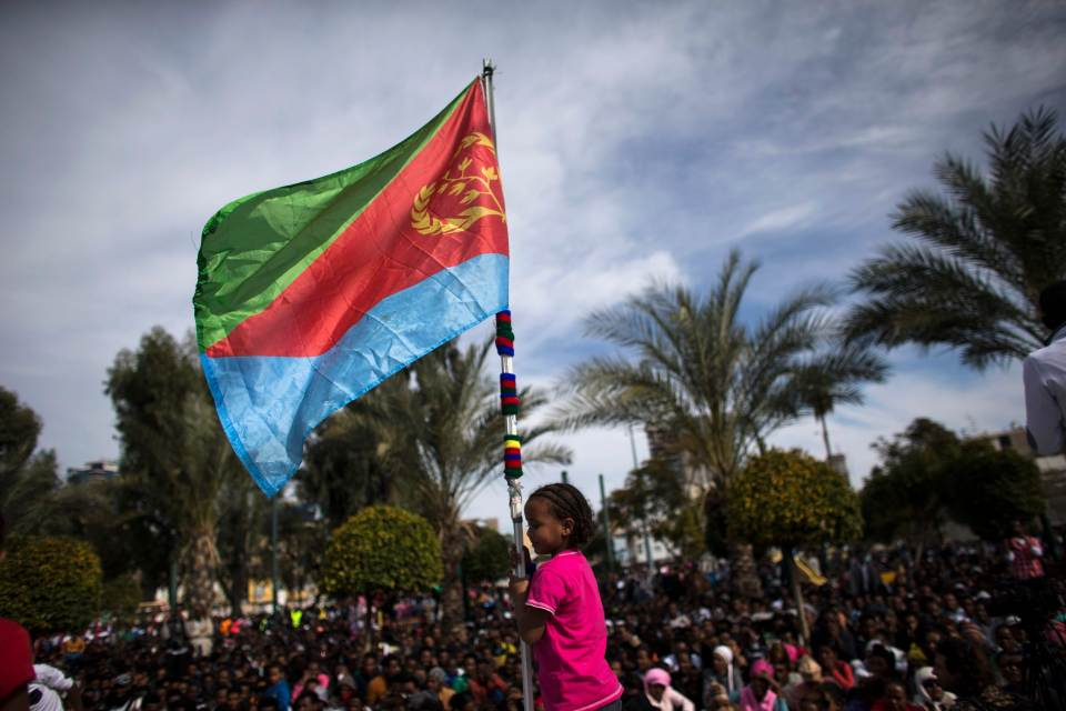 A young girl holding the Eritrea flag. Credit: REUTERS/Ronen Zvulun
