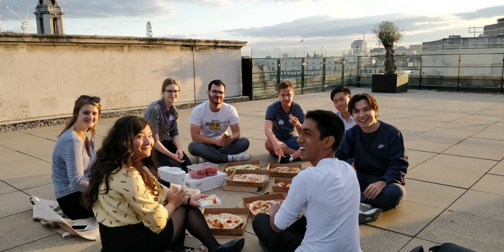 A campus team pizza social on the roof of our London offices.