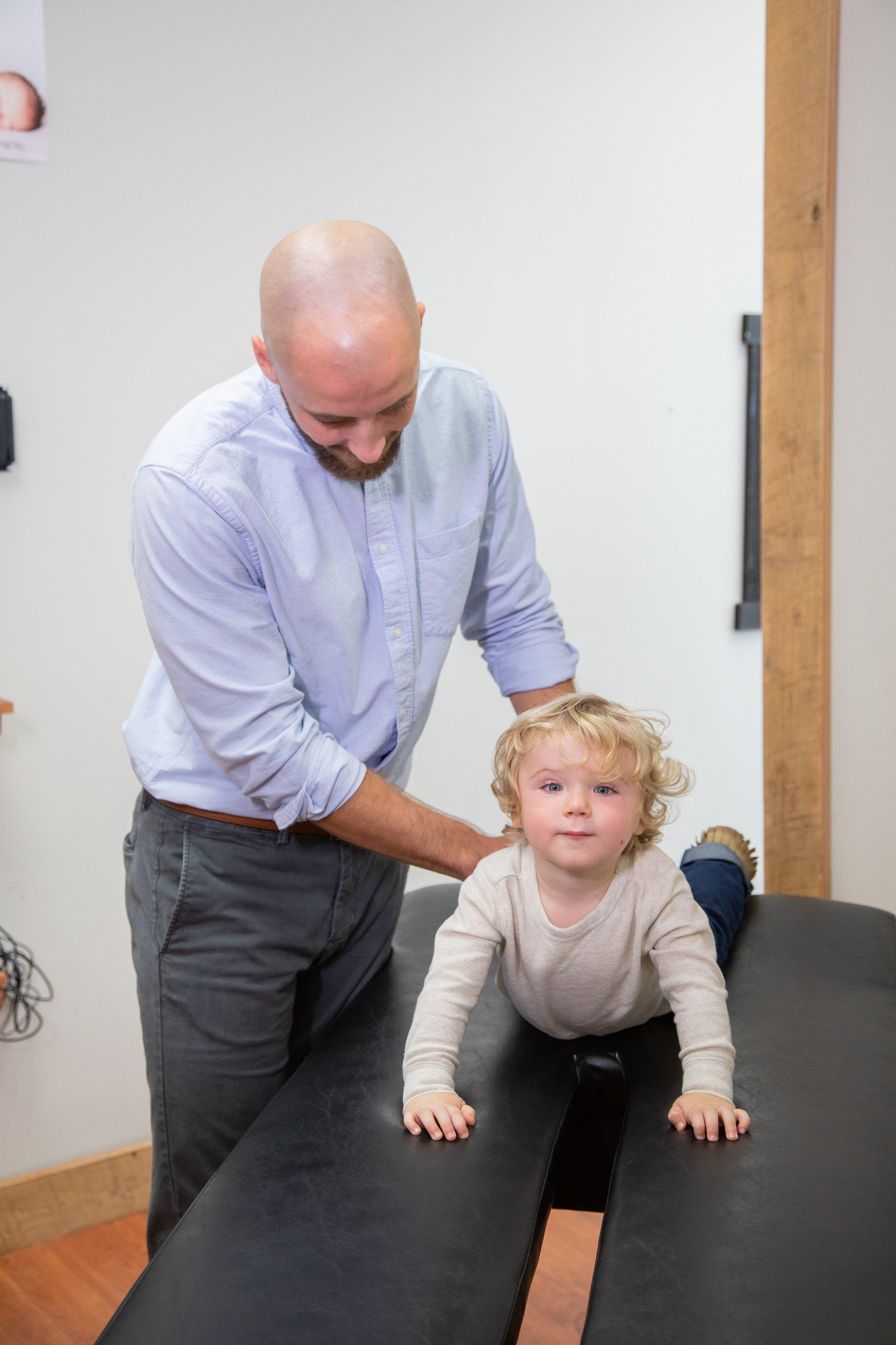 chiropractor-adjusting-kid-child.jpg