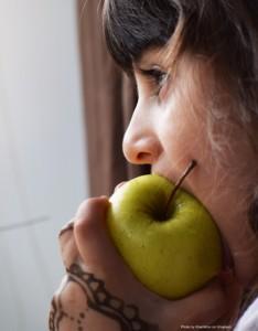 Girl-eating-apple-234x300.jpg