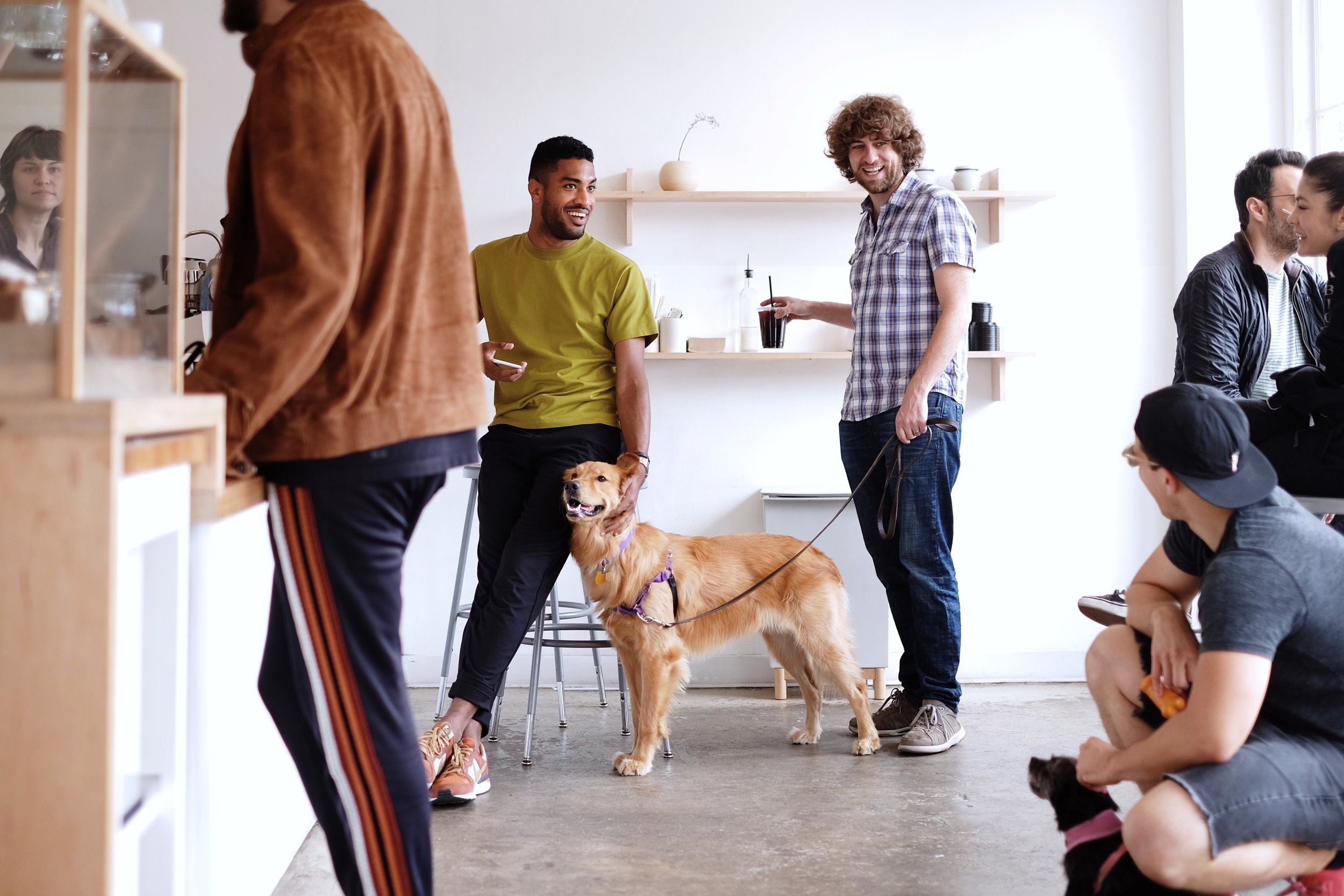 A typical weekend at Maru— neighbors, caffeine, and puppies.