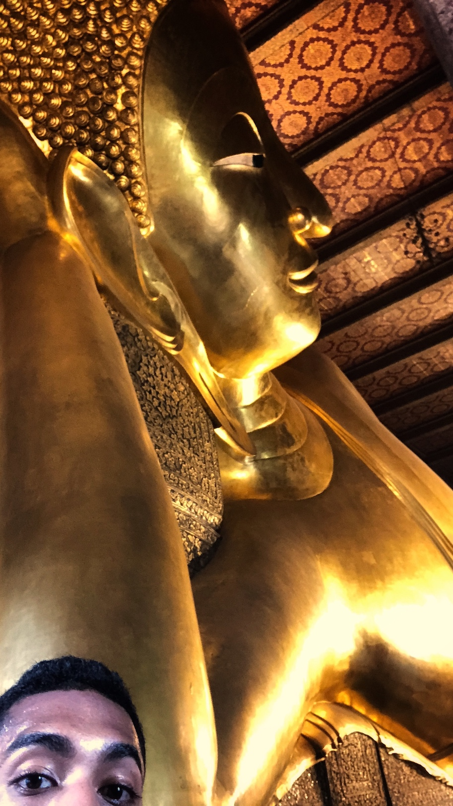 The reclining buddha at Wat Pho in Bangkok, Thailand.