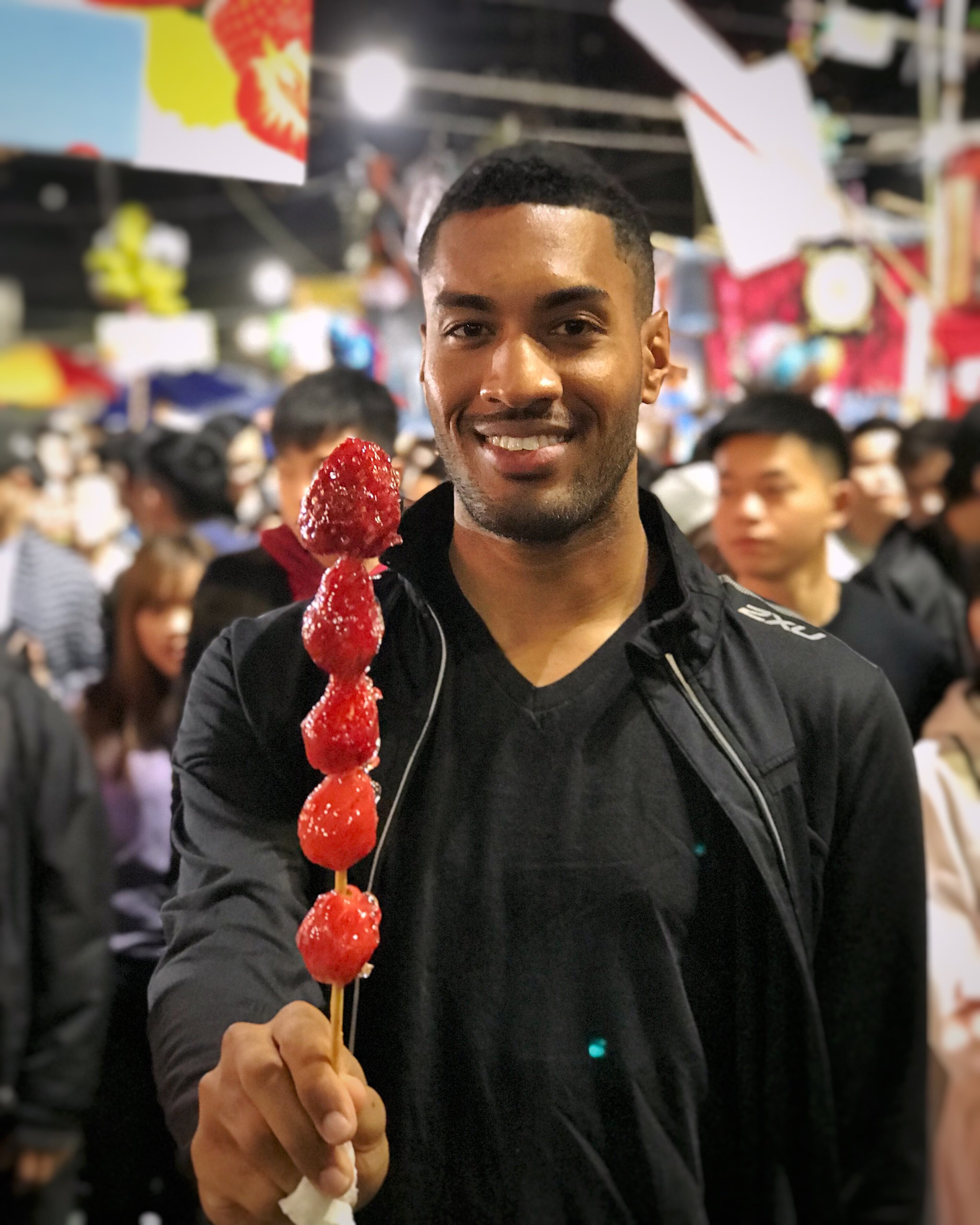 Celebrating the Year of the Dog with frozen candied strawberries at the Lunar New Year Market.