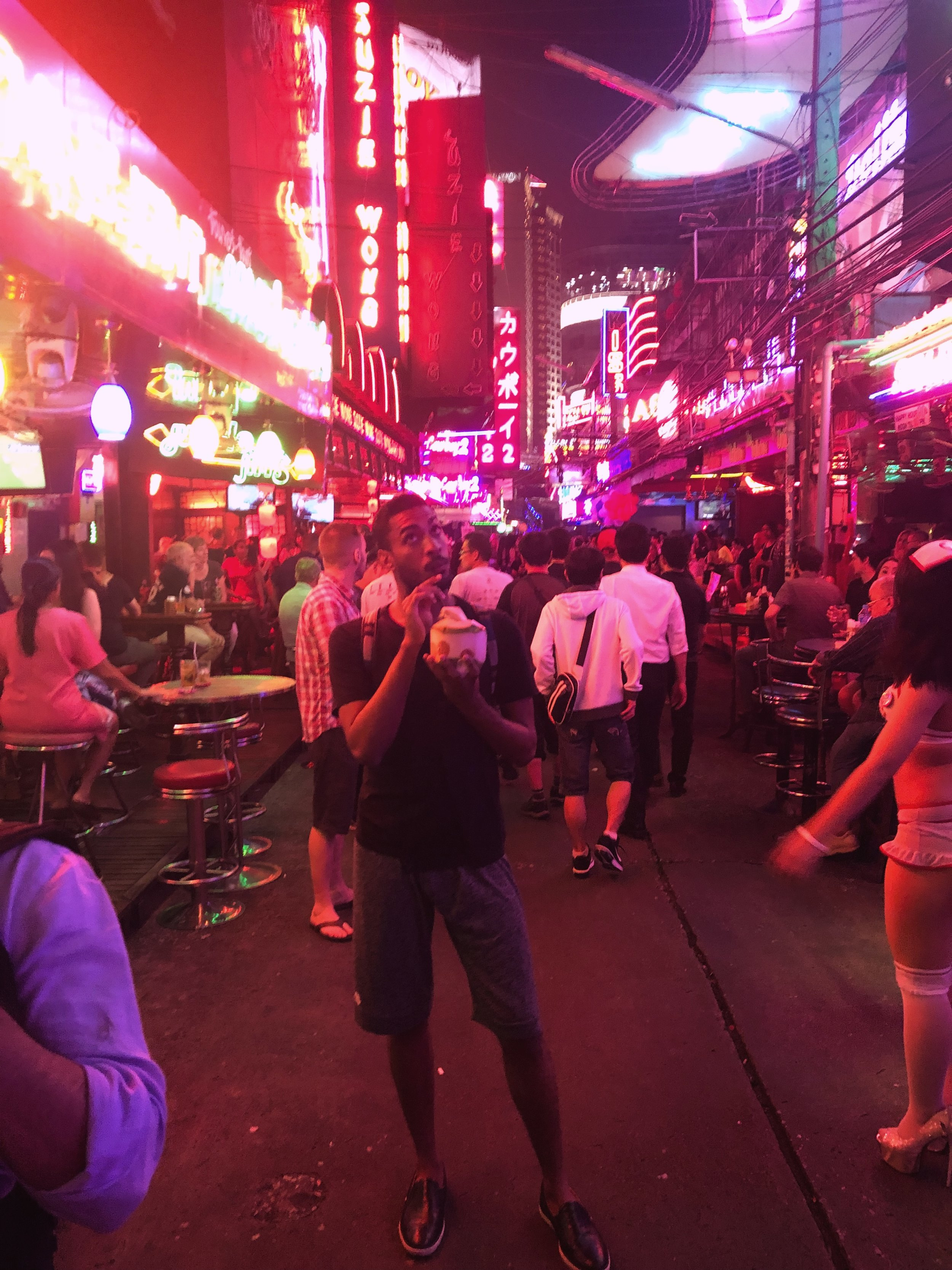 Minding my business in one of Bangkok's red light districts.