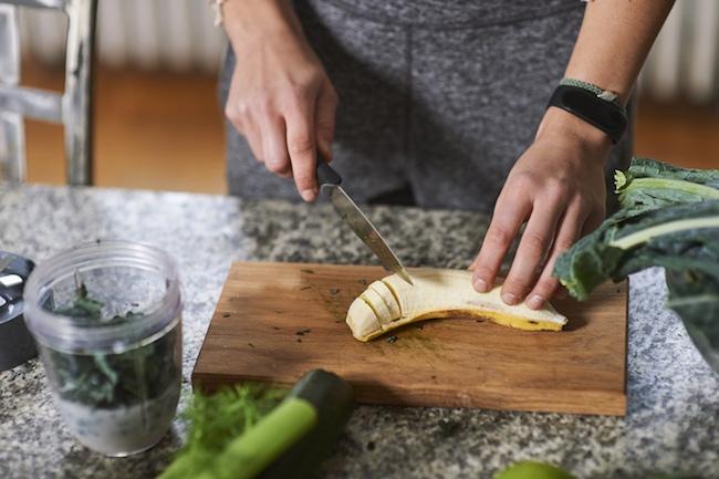 Woman Cutting Banana