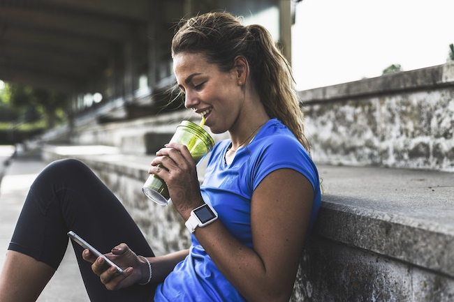 Woman Drinking Smoothie After Exercise