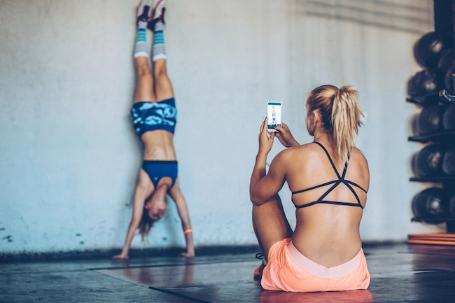 Women Working out Taking Pictures