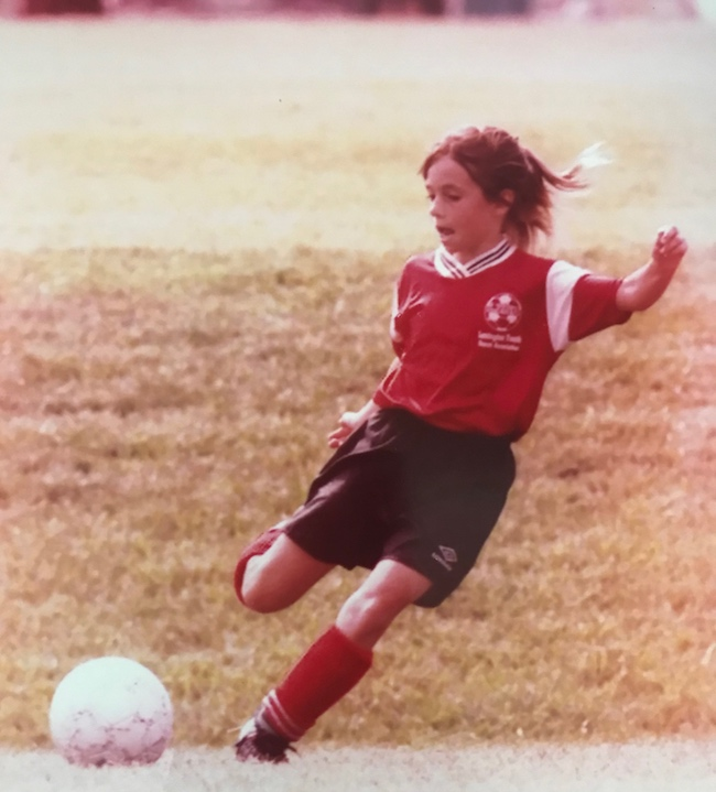 Annie Grossman Playing Soccer as Kid.jpg