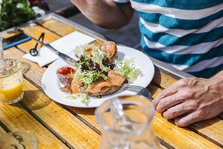 Man Eating Smoked Salmon