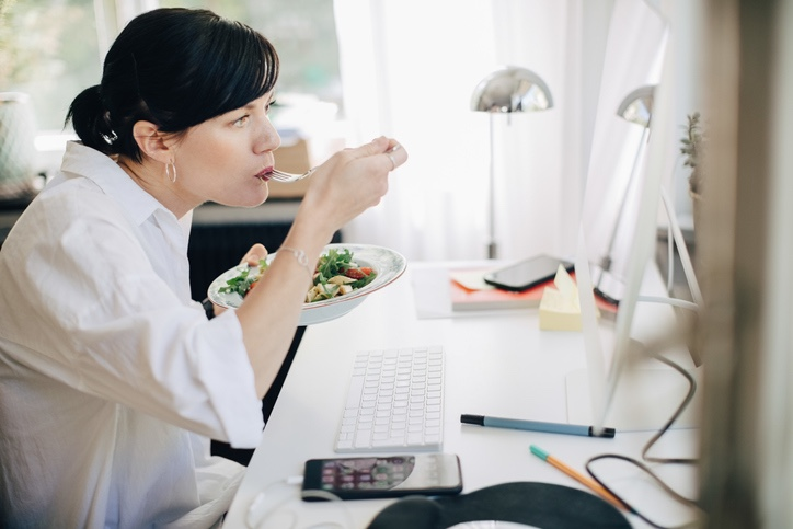 Woman Eating Salad at Desk