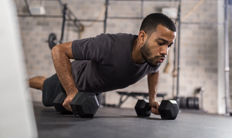 Man Doing Push Ups with Weights