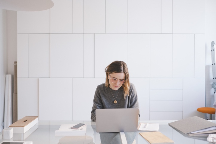 Woman Working Sitting at Desk