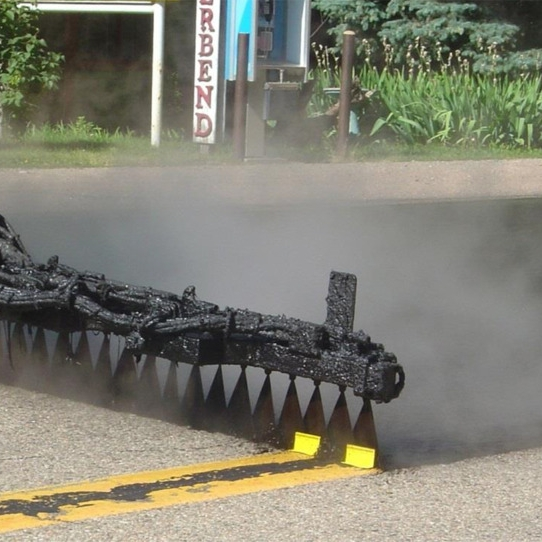 Asphalt Tack Coat - A relatively thin application of asphalt binder applied to an existing asphalt concrete or PCC surface at a prescribed rate. Asphalt emulsion diluted with water is the preferred type. It is used to form a bond between an existing surface and the overlying course.