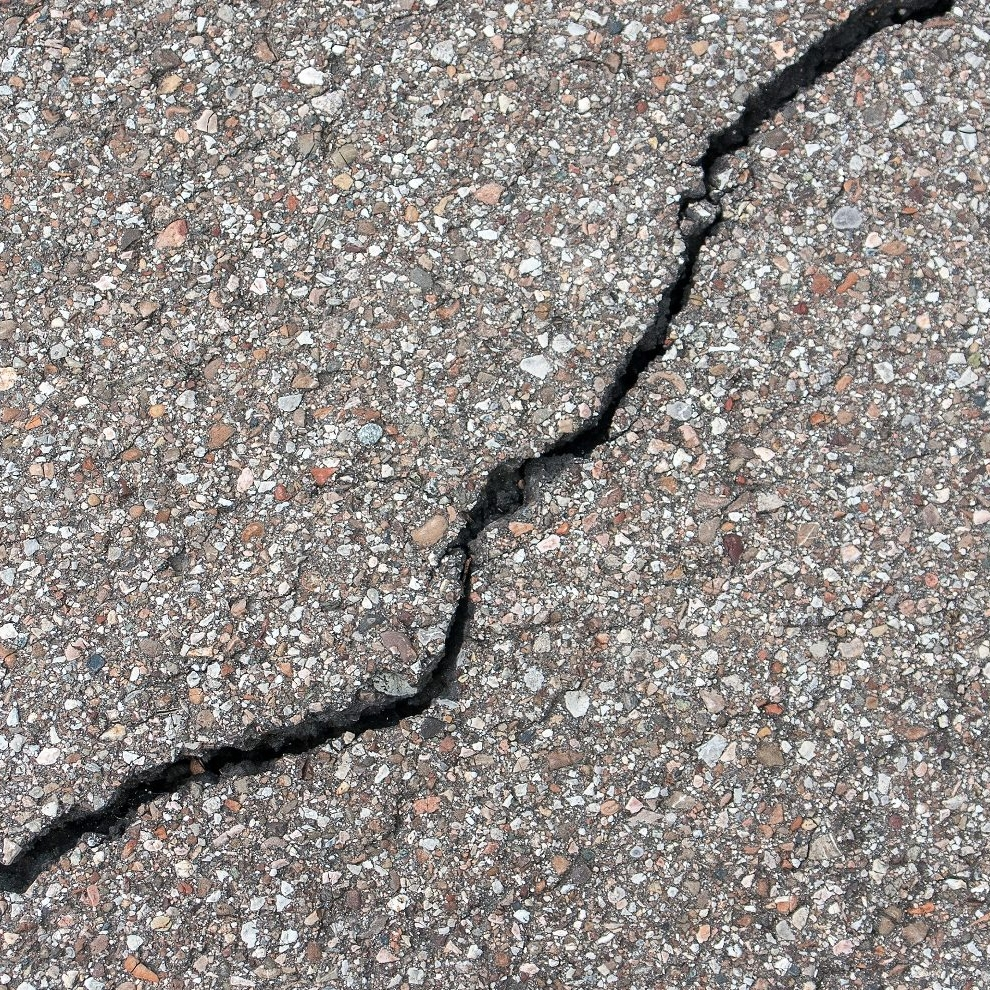 Crack - An approximately vertical random cleavage of the pavement caused by traffic loading, thermal stresses and/or aging of the binder.