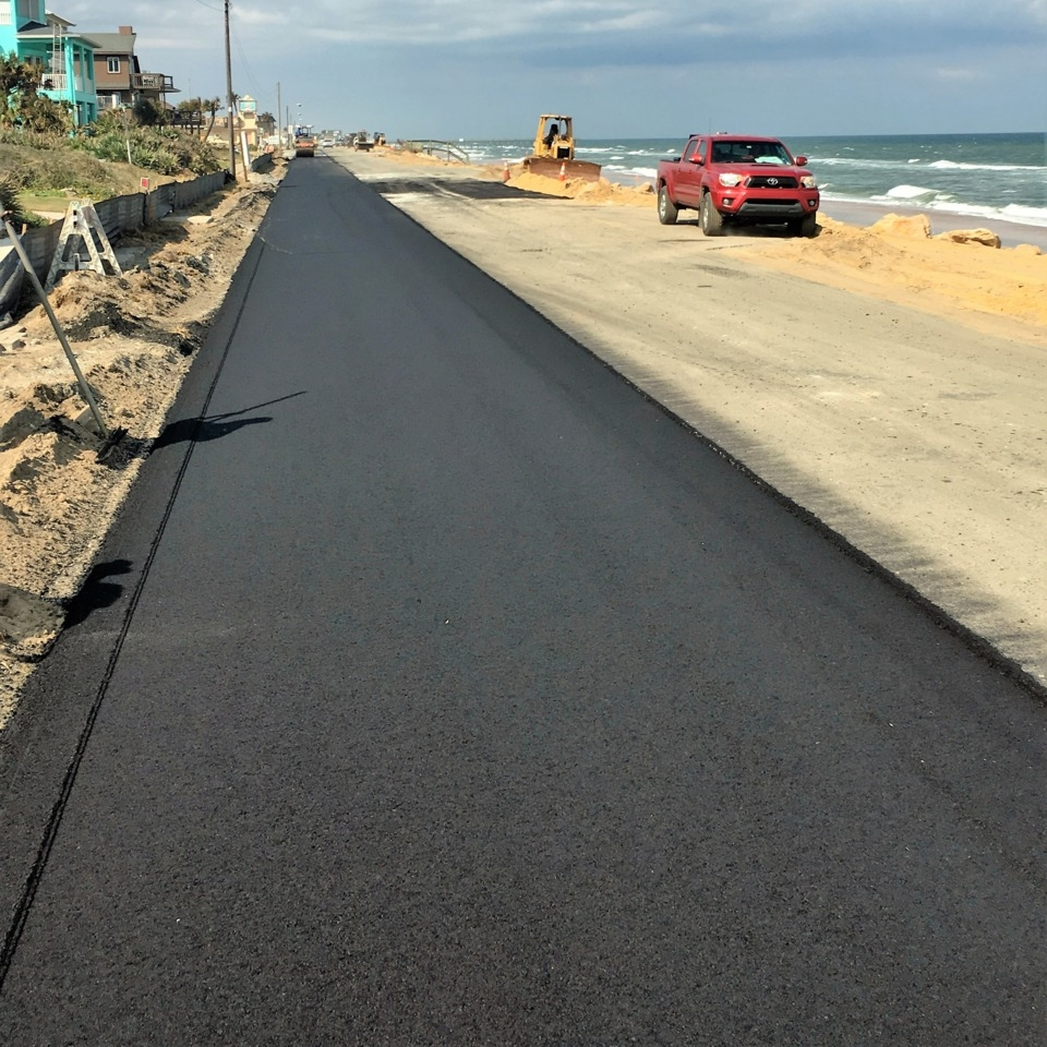 Lift - A layer or course of paving material applied to a base or a previous layer.