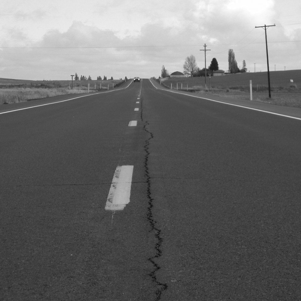 Longitudinal Crack - A vertical crack in the pavement that follows a course approximately parallel to the centerline.