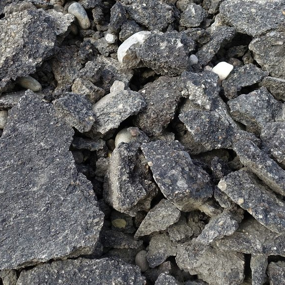 Reclaimed Asphalt Pavement (RAP) - Excavated asphalt pavement that has been pulverized, usually by milling, and is used like an aggregate in the recycling of asphalt pavements.