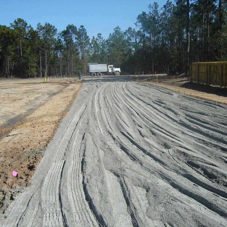 Soil/Cement Base - A hardened material formed by curing a mechanically mixed and compacted mixture of pulverized soil, portland cement and water used as a layer in a pavement system to reinforce and protect the subgrade or subbase.