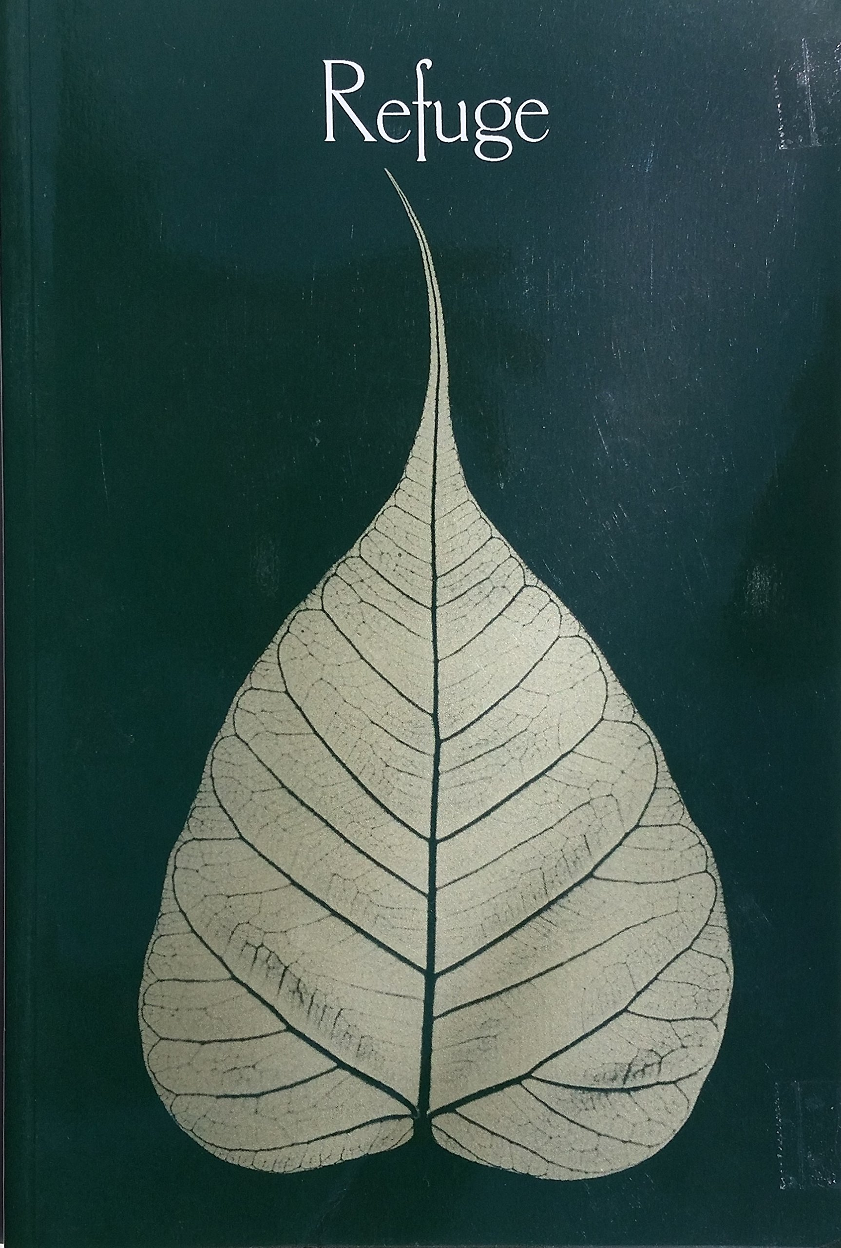 """Leaf with the word """"refuge"""" above."""