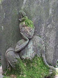 Stone relief carving of a relaxed Buddha
