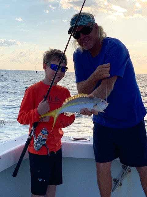 This is my son Riley and our captain in the Keys. We charted a boat from Bud 'n Mary's.