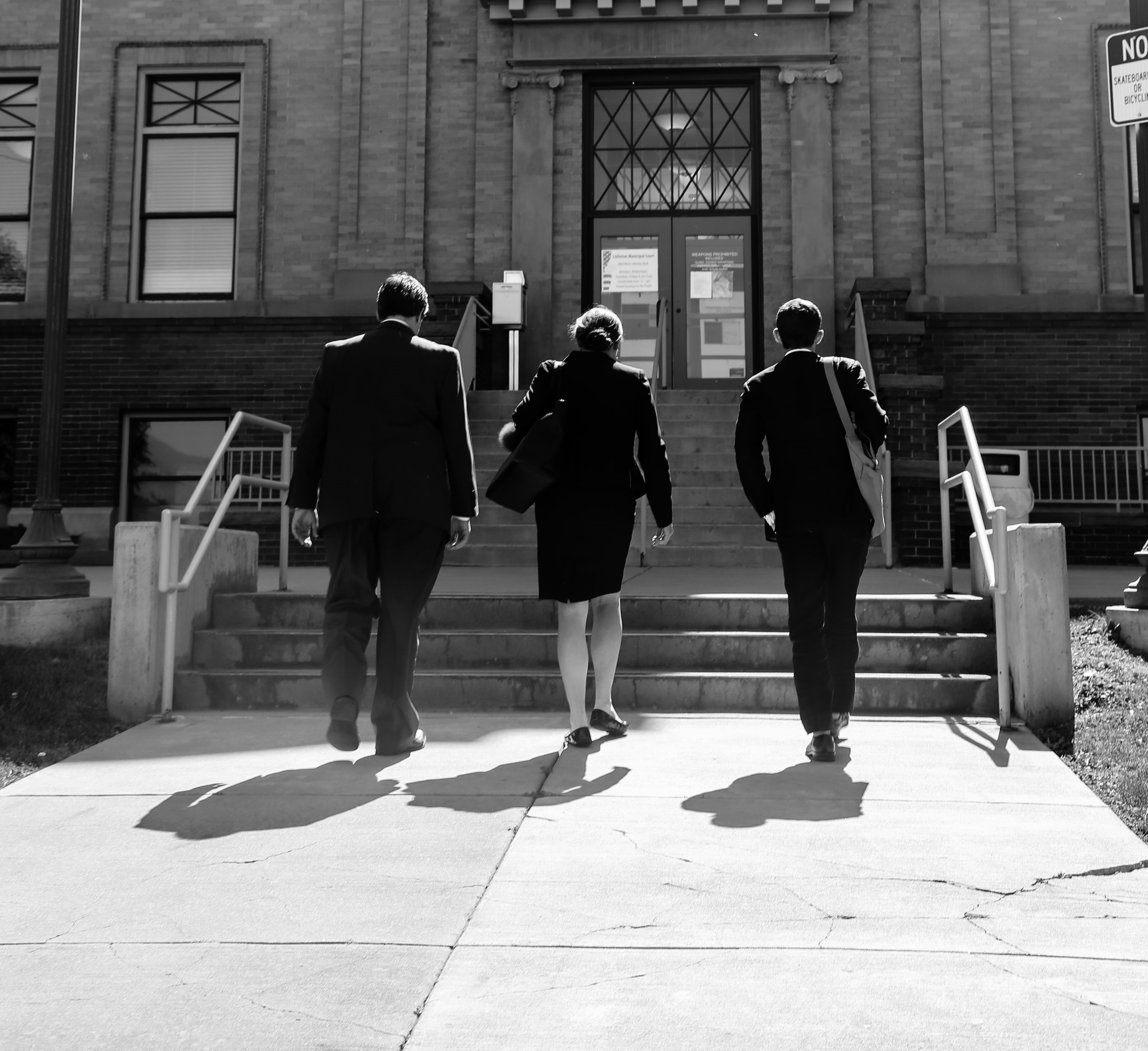 Attorneys at JLongtin Law walking out of a courthouse.