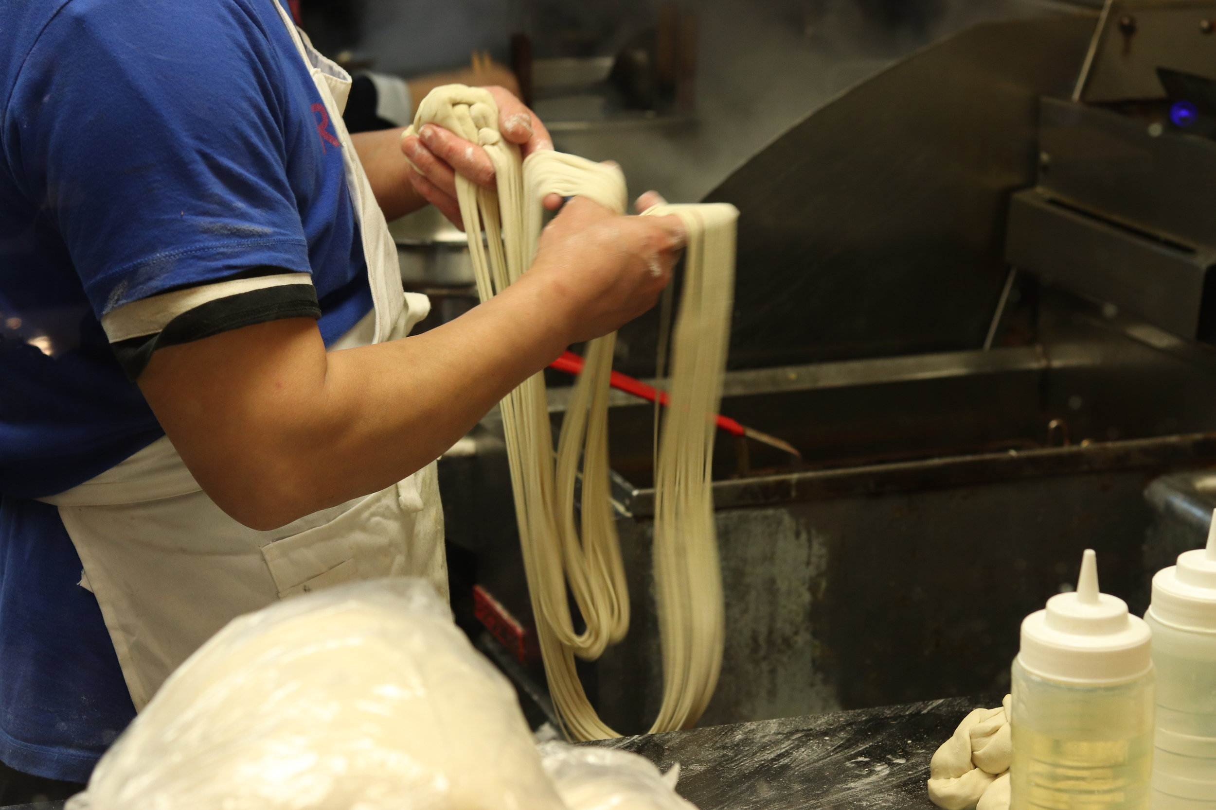 Pulling the hand drawn noodles