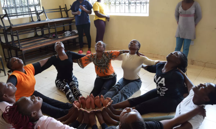 Inmates say the yoga sessions have helped them accept their situation and find emotional balance. Photograph: Daniel Wesangula