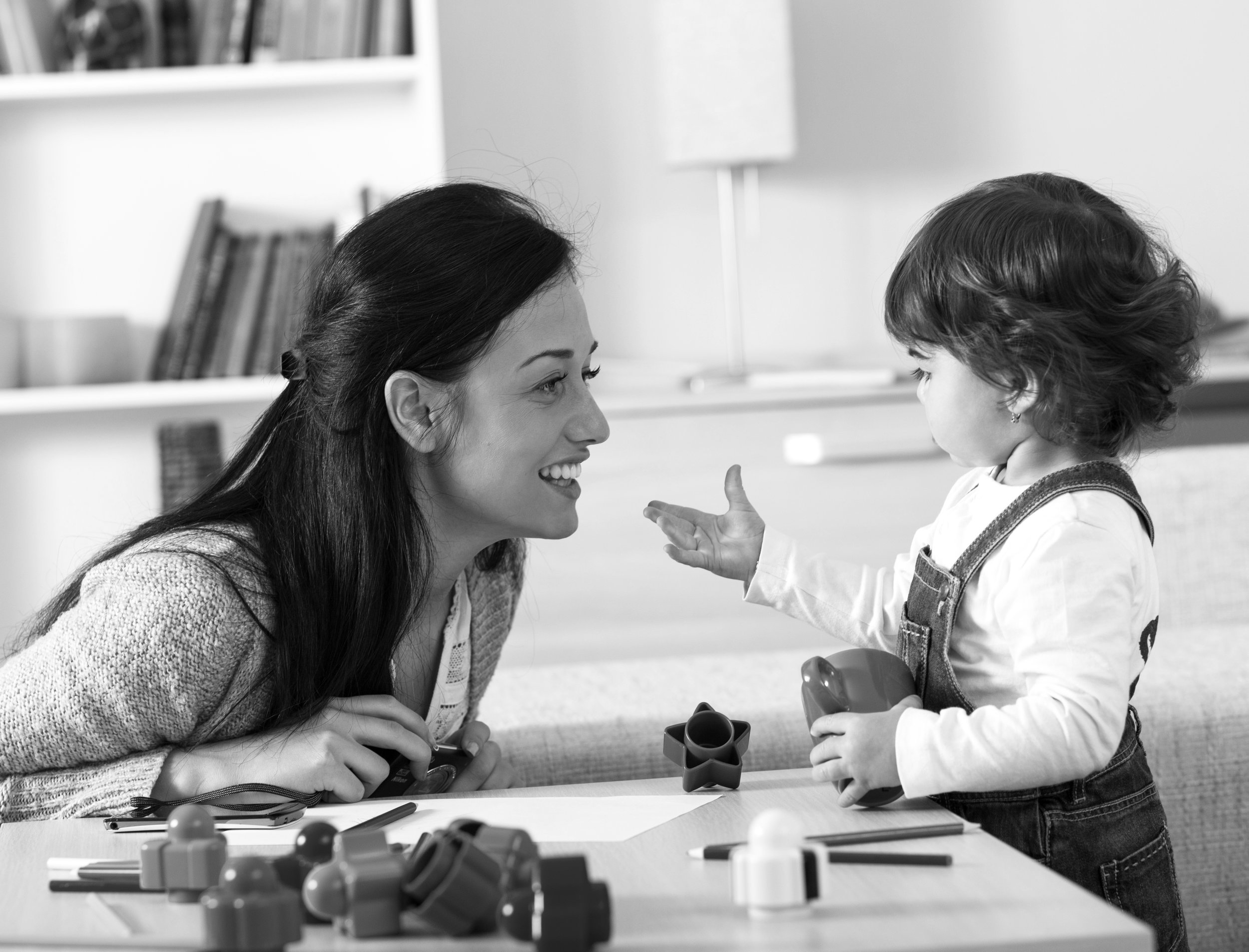 Mother and baby girl playing with toys in living room bw.jpg