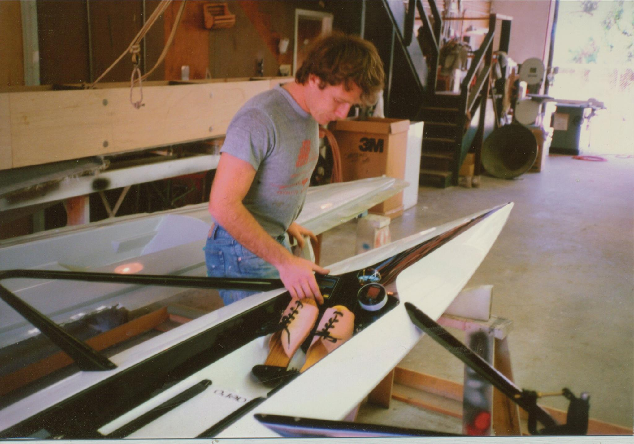 Maas Boat Company in 1988, and Chris Maas checking electronics on Bill Berger's new Aero, set up for Catalina racing.
