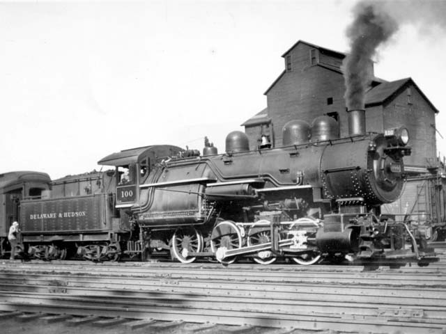D&H 100 TYPE:  0-8-0  CLASS:  B-6  DATE:  8/1/46  LOCATION:  Saratoga, NY  NOTES:  Built from E-3a's #887 frame and boiler from 2nd 884 in April, 1930 and sold to Luria in August, 1953.  PHOTOGRAPHER:  Charles Elston,  (Jim Wright Collection)