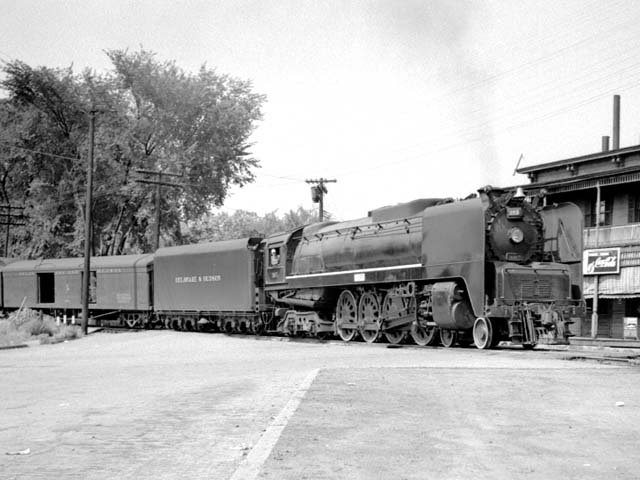 D&H 305 TYPE:  4-8-4  CLASS:  K  DATE:  8/1/47  LOCATION:  Fort Edward, NY  NOTES:  Turning on south wye; will lead Lake George-New York passenger from from Fort Edward to Troy after train arrives off Lake George branch. Built by Alco-Schenectady in 1943, Sold to Luria in August, 1953.  PHOTOGRAPHER:  Jim Wright