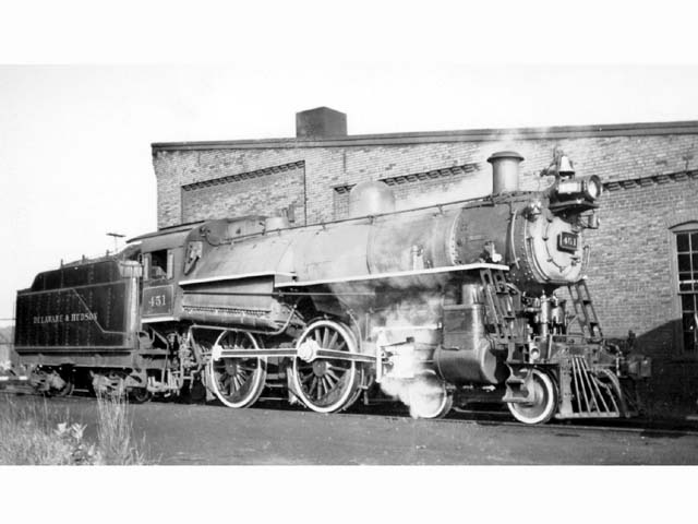 D&H 451 TYPE:  4-4-0  CLASS:  G-5  DATE:  8/1/46  LOCATION:  Saratoga, NY  NOTES:  This picture was taken August 8, 1946. 18 days later, on August 26, the 451 was wrecked in a head on collision at the Glen, NY, while heading a northbound passenger train on the North Creek branch. Its engineer, with more than 40 years of service, died at the throttle. Cause of the accident was found to be the failure of a southbound extra, headed by the 503, to wait at a meeting point.  PHOTOGRAPHER:  Charles Elston,  (Jim Wright Collection)